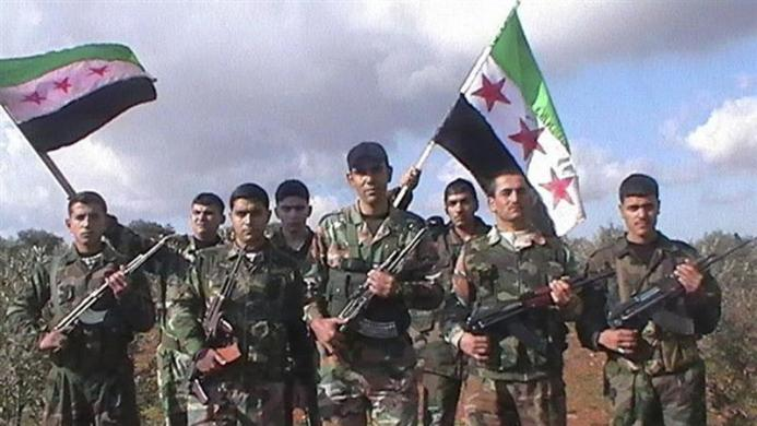 Handout photo of Syrian soldiers who defected to join the Free Syrian Army posing in the northern province of Idlib
